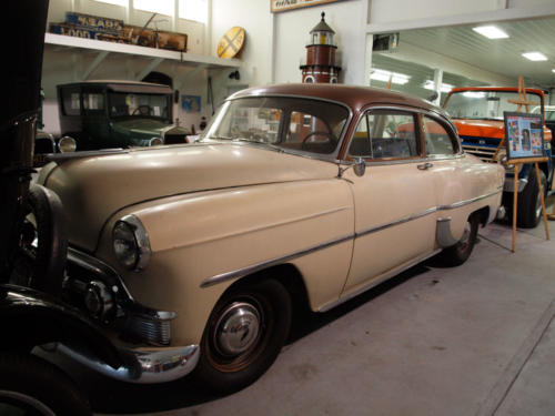 Car-Chevy-1957-TanColoredBrownRoof-DriversSide&PartialFront-7228853